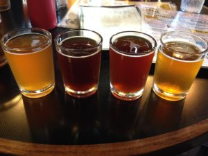 I am not a big beer drinker, but I love flights at microbreweries. It's always great to sample! (This is from Skagway Brewing Company)